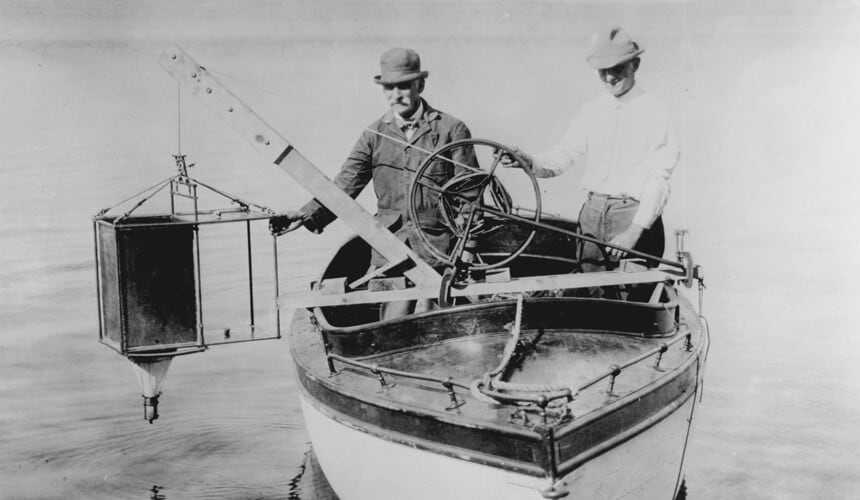 Birge and Juday plankton: Birge and Juday with a plankton trap on Lake Mendota, circa 1917. (Image courtesy of the UW Digital Collections Center.)