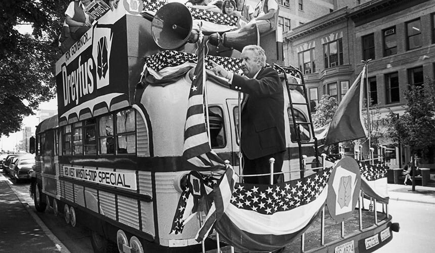 Lee Dreyfus campaigning on his refitted school bus.